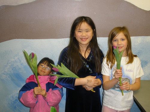 Girls Holding Tulips - The Great Tulip Trade
