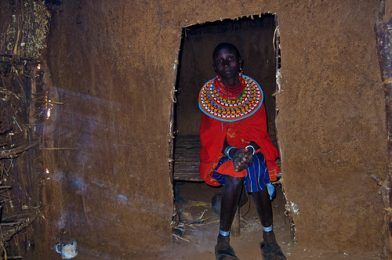 Inside a Samburu home with the wife of a Samburu Chief. She is dressed in her finest native costure and handcrafted jewely. in the Satima – Nalare village